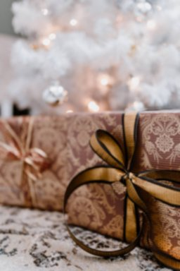 kaboompics_elegantly wrapped gifts with golden ribbon.jpg